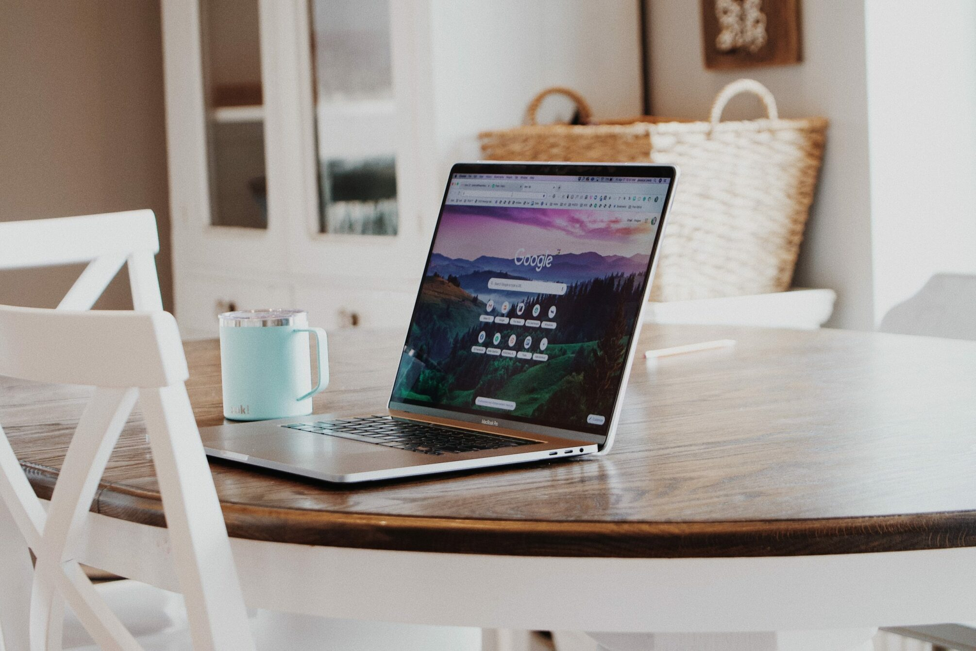 Laptop on a dining table with the google search screen open